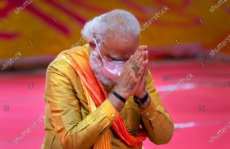 Indian Prime Minister Narendra Modi performs rituals during the groundbreaking ceremony of a temple dedicated to the Hindu god Ram, in Ayodhya, India, . Hindus rejoiced as Modi broke ground on a long-awaited temple of their most revered god, Ram, at the site of a demolished 16th century mosque