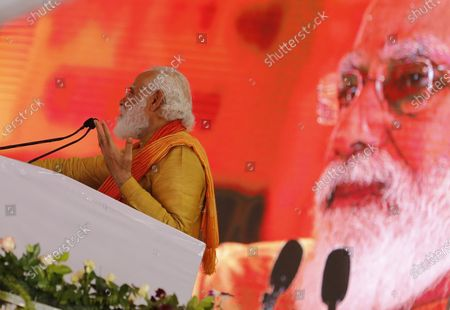 Indian Prime Minister Narendra Modi addresses a gathering during the groundbreaking ceremony of a temple dedicated to the Hindu god Ram, in Ayodhya, India, . Hindus rejoiced as Modi broke ground on a long-awaited temple of their most revered god, Ram, at the site of a demolished 16th century mosque