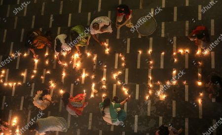 Hindu devotees light earthen lamps inside the premises of Vishva Hindu Parishad (VHP), an Indian right-wing Hindu organisation's headquarters as they celebrate Lord Rama - one of the seven incarnations of the God Vishnu, according to Hindu mythology - in New Delhi, India, 05 August 2020. Indian Prime Minister Narendra Modi laid the foundation stone of the Rama Temple in Ayodhya, Uttar Pradesh, on 05 August, months after India's Supreme Court ruled that the site should be given to Hindus after a dispute concerning the control of the area, regarded as the birthplace of Lord Rama. The site had previously hosted the Babri Masjid, a mosque destroyed by Hindu nationalists in 1992. The courts also ruled that Muslim devotees would be assigned a separate lot to rebuild the mosque.