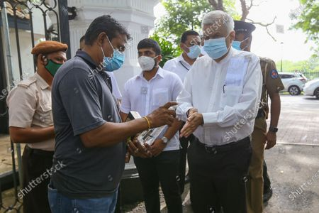 Leader of the United National Party (UNP) Ranil Wickremesinghe, sanitise his hands before entering a polling station during the parliamentary election, in Colombo, Sri Lanka, 05 August 2020. Nearly 16.2 million registered voters will go to the polls today to elect 225 Members of Parliament.