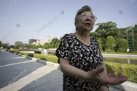 """Koko Kondo speaks during an interview with The Associated Press near Hiroshima Peace Memorial Museum in Hiroshima, western Japan, . Kondo was determined to find the person who dropped the atomic bomb on Hiroshima, western Japan, the person that caused the suffering and the terrible facial burns of the girls at her father's church - and then square off and punch them in the face. Ten-year-old Kondo appeared on an American TV show called """"This is Your Life"""" that was featuring her father, Rev. Kiyoshi Tanimoto, one of six survivors profiled in John Hersey's book """"Hiroshima."""" Kondo stared in hatred at another guest: Capt. Robert Lewis, co-pilot of B-29 bomber Enola Gay that dropped the bomb"""