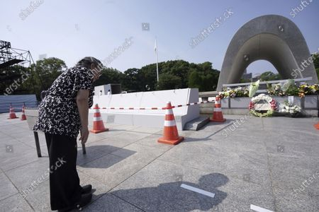 """Koko Kondo prays at the cenotaph for the atomic bombing victims near Hiroshima Peace Memorial Museum in Hiroshima, western Japan, . Kondo was determined to find the person who dropped the atomic bomb on Hiroshima, western Japan, the person that caused the suffering and the terrible facial burns of the girls at her father's church - and then square off and punch them in the face. Ten-year-old Kondo appeared on an American TV show called """"This is Your Life"""" that was featuring her father, Rev. Kiyoshi Tanimoto, one of six survivors profiled in John Hersey's book """"Hiroshima."""" Kondo stared in hatred at another guest: Capt. Robert Lewis, co-pilot of B-29 bomber Enola Gay that dropped the bomb"""