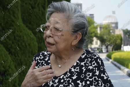 """Koko Kondo speaks during an interview with The Associated Press with a backdrop of Atomic Bomb Dome near Hiroshima Peace Memorial Museum in Hiroshima, western Japan, . Kondo was determined to find the person who dropped the atomic bomb on Hiroshima, western Japan, the person that caused the suffering and the terrible facial burns of the girls at her father's church - and then square off and punch them in the face. Ten-year-old Kondo appeared on an American TV show called """"This is Your Life"""" that was featuring her father, Rev. Kiyoshi Tanimoto, one of six survivors profiled in John Hersey's book """"Hiroshima."""" Kondo stared in hatred at another guest: Capt. Robert Lewis, co-pilot of B-29 bomber Enola Gay that dropped the bomb"""