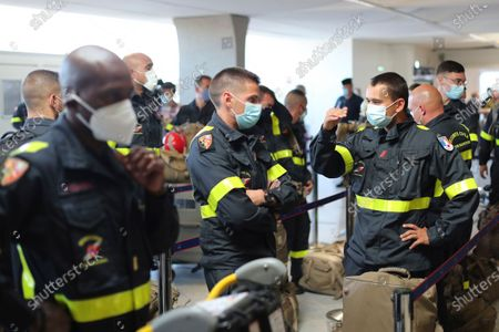 Stock Picture of Members of the Securite Civile rescue organisation wait in line before boarding a plane at Charles de Gaulle airport, north of Paris, Wednesday, Aug.5, 2020. France is sending two planes to Lebanon on Wednesday with dozens of emergency workers, a mobile medical unit and 15 tons of aid. The aid is expected to arrive Wednesday afternoon and should allow for the treatment of some 500 blast victims, according to French President Emmanuel Macron's office