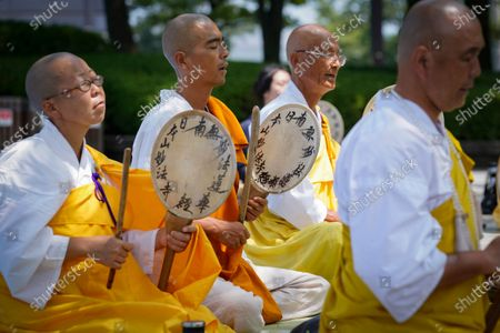 Monks beat hand drums as they pray before the Atomic Bomb Dome at Peace Memorial Park in Hiroshima, Japan, 05 August 2020. On 06 August 2020 Japan will mark the 75th anniversary of the bombing of Hiroshima. In 1945 the United States dropped two nuclear bombs over the cities of Hiroshima and Nagasaki on 06 and 09 August respectively, killing more than 200,000 people. This year's annual commemoration events were either canceled or scaled down amid the ongoing coronavirus pandemic.