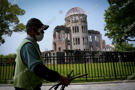A man walks past the Atomic Bomb Dome at Peace Memorial Park in Hiroshima, Japan, 05 August 2020. On 06 August 2020 Japan will mark the 75th anniversary of the bombing of Hiroshima. In 1945 the United States dropped two nuclear bombs over the cities of Hiroshima and Nagasaki on 06 and 09 August respectively, killing more than 200,000 people. This year's annual commemoration events were either canceled or scaled down amid the ongoing coronavirus pandemic.