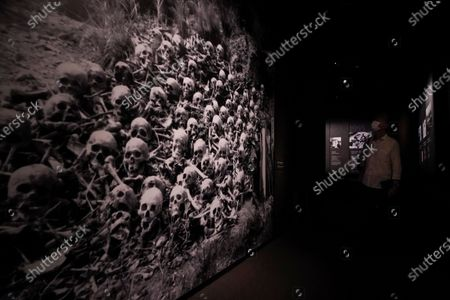 A visitor looks at photographs of human remains in the aftermath of the 1945 Hiroshima bombing, at the Hiroshima Peace Memorial Museum in Hiroshima, Japan, 05 August 2020. On 06 August 2020 Japan will mark the 75th anniversary of the bombing of Hiroshima. In 1945 the United States dropped two nuclear bombs over the cities of Hiroshima and Nagasaki on 06 and 09 August respectively, killing more than 200,000 people. This year's annual commemoration events were either canceled or scaled down amid the ongoing coronavirus pandemic.