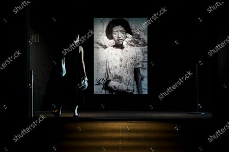 A visitor looks at photographs of the Hiroshima bombing survivors, at the Hiroshima Peace Memorial Museum in Hiroshima, Japan, 05 August 2020. On 06 August 2020 Japan will mark the 75th anniversary of the bombing of Hiroshima. In 1945 the United States dropped two nuclear bombs over the cities of Hiroshima and Nagasaki on 06 and 09 August respectively, killing more than 200,000 people. This year's annual commemoration events were either canceled or scaled down amid the ongoing coronavirus pandemic.