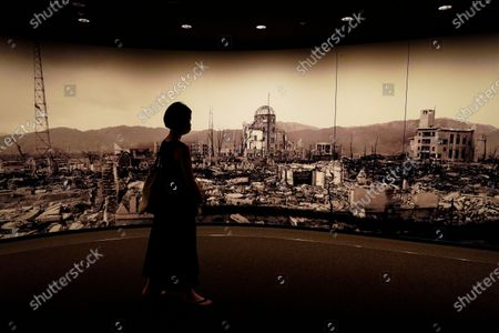 A visitor looks at photographs of the Hiroshima bombing aftermath, at the Hiroshima Peace Memorial Museum in Hiroshima, Japan, 05 August 2020. On 06 August 2020 Japan will mark the 75th anniversary of the bombing of Hiroshima. In 1945 the United States dropped two nuclear bombs over the cities of Hiroshima and Nagasaki on 06 and 09 August respectively, killing more than 200,000 people. This year's annual commemoration events were either canceled or scaled down amid the ongoing coronavirus pandemic.