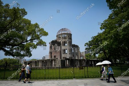 People walk past the Atomic Bomb Dome at Peace Memorial Park in Hiroshima, Japan, 05 August 2020. On 06 August 2020 Japan will mark the 75th anniversary of the bombing of Hiroshima. In 1945 the United States dropped two nuclear bombs over the cities of Hiroshima and Nagasaki on 06 and 09 August respectively, killing more than 200,000 people. This year's annual commemoration events were either canceled or scaled down amid the ongoing coronavirus pandemic.