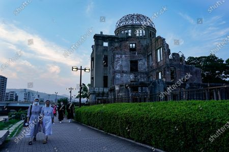 Catholic nuns walk past the Atomic Bomb Dome at Peace Memorial Park in Hiroshima, western Japan, 05 August 2020. On 06 August 2020 Japan will mark the 75th anniversary of the bombing of Hiroshima. In 1945 the United States dropped two nuclear bombs over the cities of Hiroshima and Nagasaki on 06 and 09 August respectively, killing more than 200,000 people. This year's annual commemoration events were either canceled or scaled down amid the ongoing coronavirus pandemic.