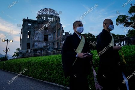 Buddhist monks walk past the Atomic Bomb Dome at Peace Memorial Park in Hiroshima, western Japan, 05 August 2020. On 06 August 2020 Japan will mark the 75th anniversary of the bombing of Hiroshima. In 1945 the United States dropped two nuclear bombs over the cities of Hiroshima and Nagasaki on 06 and 09 August respectively, killing more than 200,000 people. This year's annual commemoration events were either canceled or scaled down amid the ongoing coronavirus pandemic.