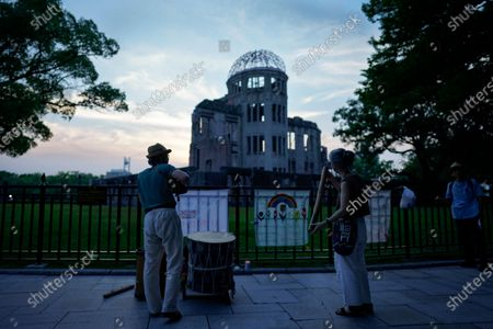 Street musicians play music to pray for the victims in front of the Atomic Bomb Dome Peace Memorial Park in Hiroshima, western Japan, 05 August 2020. On 06 August 2020 Japan will mark the 75th anniversary of the bombing of Hiroshima. In 1945 the United States dropped two nuclear bombs over the cities of Hiroshima and Nagasaki on 06 and 09 August respectively, killing more than 200,000 people. This year's annual commemoration events were either canceled or scaled down amid the ongoing coronavirus pandemic.