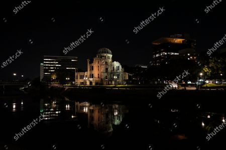 The Atomic Bomb Dome (C) is reflected in the water of Motoyasu River at Peace Memorial Park in Hiroshima, western Japan, 05 August 2020. On 06 August 2020 Japan will mark the 75th anniversary of the bombing of Hiroshima. In 1945 the United States dropped two nuclear bombs over the cities of Hiroshima and Nagasaki on 06 and 09 August respectively, killing more than 200,000 people. This year's annual commemoration events were either canceled or scaled down amid the ongoing coronavirus pandemic.