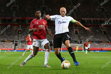 Timothy Fosu-Mensah of Manchester United and Gernot Trauner of LASK