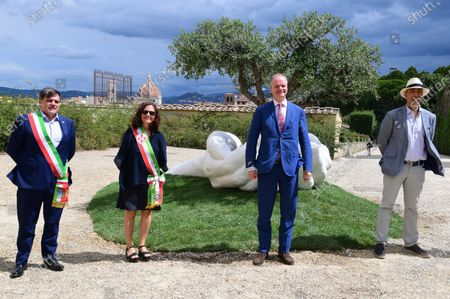Stock Picture of The artist Lorenzo Quinn with Eike Schmidt director Uffizi Museums, deputy mayor of Florence Cristina Giachi, Stefano Giovannetti mayor of  Pietrasanta during the presentation of the artwork ' Give ' to the Boboli Gardens