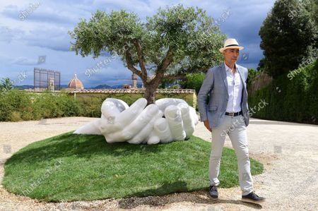 The artist Lorenzo Quinn and his the artwork ' Give ' to the Boboli Gardens