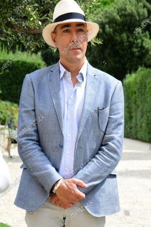 Stock Picture of The artist Lorenzo Quinn during the presentation of the his artwork ' Give ' to the Boboli Gardens