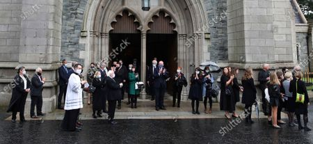 Mourners including the President of Ireland Michael D. Higgins, applauds as the funeral cortege of the the former Northern Ireland lawmaker and Nobel Peace Prize winner John Hume leaves following the funeral Mass at St Eugene's Cathedral in Londonderry, Northern Ireland, . Hume was co-recipient of the 1998 Nobel Peace Prize with fellow Northern Ireland lawmaker David Trimble, for his work in the Peace Process in Northern Ireland. Masks are worn due to the ongoing Coronavirus outbreak