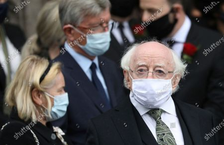 The President of Ireland Michael D. Higgins looks towards the media following the former Northern Ireland lawmaker and Nobel Peace Prize winner John Hume's funeral Mass at St Eugene's Cathedral in Londonderry, Northern Ireland, . Hume was co-recipient of the 1998 Nobel Peace Prize with fellow Northern Ireland lawmaker David Trimble, for his work in the Peace Process in Northern Ireland. Higgins is wearing a mask due to the ongoing Coronavirus outbreak