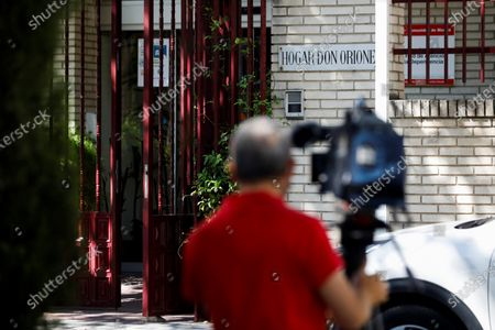 A cameraman films outside the Home Don Orione in Pozuelo de Alarcon, Madrid, Spain, 05 August 2020. At least a dozen people have tested positive for coronavirus in the center where Inaki Urdangarin, husband of Spanish Infanta Elena and brother in law of King Felipe VI, normally volunteers. Urdangarin, who is serving time after being found guilty for several charges of corruption and tax offenses, will not be able to attend his volunteering at the home with people with intellectual disabilities, due to the coronavirus outbreak.