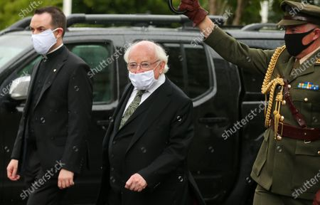 Stock Photo of Irish President Michael D Higgins arrives for the service.