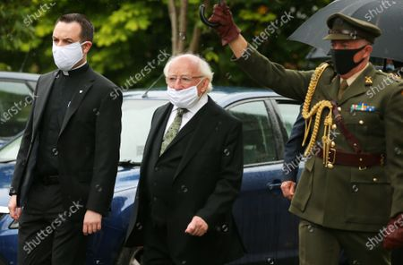 Stock Image of Irish President Michael D Higgins arrives for the service.