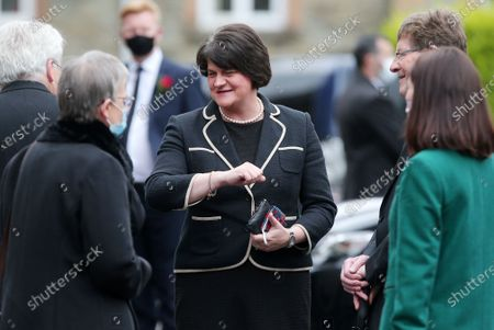 First Minister and DUP leader Arlene Foster arrives for the service and is greeted by the SDLP's Margaret Ritchie.