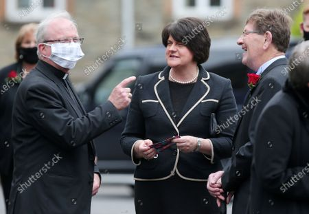 First Minister and DUP leader Arlene Foster arrives for the service and is greeted by Bishop of Derry D-nal McKeown.