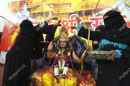 A man dressed as Lord Rama (C) is showered with flowers by Hindu devotees as they celebrate the laying of the foundation stone of the Rama temple in Ayodhya, in Bhopal, India, 05 August 2020. Indian Prime Minister Narendra Modi laid the foundation stone of the Rama Temple in Ayodhya, Uttar Pradesh, on 05 August, months after India's Supreme Court ruled that the site should be given to Hindus after a dispute concerning the control of the area, regarded as the birthplace of Lord Rama. The site had previously hosted the Babri Masjid, a mosque destroyed by Hindu nationalists in 1992. The courts also ruled that Muslim devotees would be assigned a separate lot to rebuild the mosque.