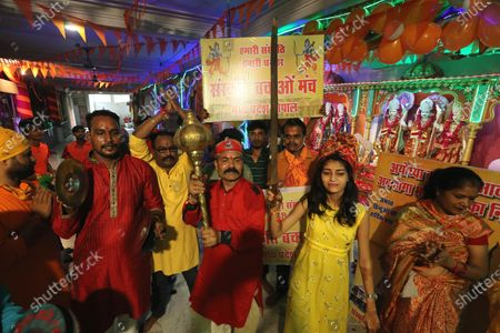 Hindu devotees celebrate the laying of the foundation stone of the Rama temple in Ayodhya, in Bhopal, India, 05 August 2020. Indian Prime Minister Narendra Modi laid the foundation stone of the Rama Temple in Ayodhya, Uttar Pradesh, on 05 August, months after India's Supreme Court ruled that the site should be given to Hindus after a dispute concerning the control of the area, regarded as the birthplace of Lord Rama. The site had previously hosted the Babri Masjid, a mosque destroyed by Hindu nationalists in 1992. The courts also ruled that Muslim devotees would be assigned a separate lot to rebuild the mosque.