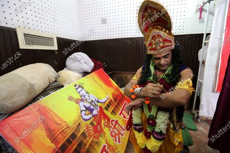 A man dressed as Lord Rama geats ready as Hindu devotees celebrate the laying of the foundation stone of the Rama temple in Ayodhya, in Bhopal, India, 05 August 2020. Indian Prime Minister Narendra Modi laid the foundation stone of the Rama Temple in Ayodhya, Uttar Pradesh, on 05 August, months after India's Supreme Court ruled that the site should be given to Hindus after a dispute concerning the control of the area, regarded as the birthplace of Lord Rama. The site had previously hosted the Babri Masjid, a mosque destroyed by Hindu nationalists in 1992. The courts also ruled that Muslim devotees would be assigned a separate lot to rebuild the mosque.