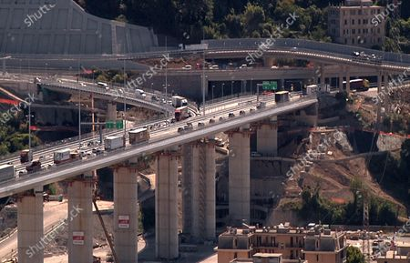 Vehicles proceed in line drive across the new Genoa-Saint George viaduct, following its reopening for traffic, in Genoa, Italy, 05 August 2020. The new viaduct was inaugurated on 03 August, two years after the Morandi bridge collapsed claiming 43 lives. The new viaduct was deisgned by award-winning architect Renzo Piano.