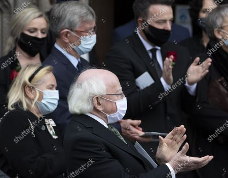 Stock Picture of Irish President Michael D Higgins (C) joins the round of applause as the remains of John Hume leave the St Eugene's Cathedral. Former SDLP leader and Nobel Prize laureate John Hume died aged 83 years old on 03 August 2020.