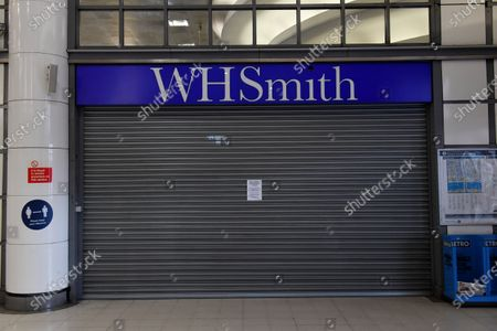 A WH Smith store in City Thameslink Station with its shutters closed.