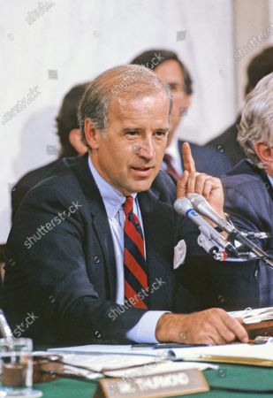 United States Senator Joseph Biden (Democrat of Delaware), Chairman, US Senate Judiciary Committee, makes his opening statement prior to hearing the testimony of Professor Anita Hill during the hearings to confirm Judge Clarence Thomas as Associate Justice of the US Supreme Court in the US Senate Caucus Room in Washington, DC. Thomas was nominated for the position by US President George H.W. Bush on July 1, 1991 to replace retiring Justice Thurgood Marshall.