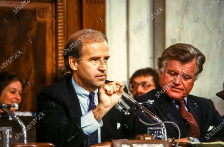 """United States Senator Joseph Biden (Democrat of Delaware), Chairman, US Senate Committee on the Judiciary, makes remarks as he chairs the confirmation vote for Judge Robert Bork, US President Ronald Reagan's nominee to succeed Associate Justice of the Supreme Court Louis Powell on Capitol Hill in Washington, D.C.. US Senator Edward M. """"Ted"""" Kennedy (Democrat of Massachusetts) looks on from right."""