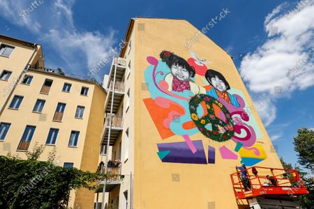 Street artists Jesus Cruz Artiles, aka 'Eme Freethinker' (L), and Francesco Nolli, aka 'Pen Chill', work on a mural for the 75th anniversary of the atomic bombing of Hiroshima and Nagasaki, in Berlin, Germany, 05 August 2020. Commissioned by Greenpeace the 10x10 meter mural stands for Peace and against nuclear weapons. On 06 August 1945 the first atomic bomb was dropped on the Japanese city of Hiroshima and three days later a second bomb hit Nagasaki. Over 200,000 people died in the attacks.