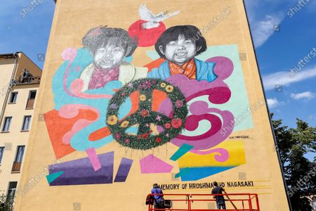 Street artists Jesus Cruz Artiles, aka 'Eme Freethinker' (L), and Francesco Nolli, aka Pen Chill, work on a mural for the 75th anniversary of the atomic bombing of Hiroshima and Nagasaki, in Berlin, Germany, 05 August 2020. Commissioned by Greenpeace the 10x10 meter mural stands for Peace and against nuclear weapons. On 06 August 1945 the first atomic bomb was dropped on the Japanese city of Hiroshima and three days later a second bomb hit Nagasaki. Over 200,000 people died in the attacks.