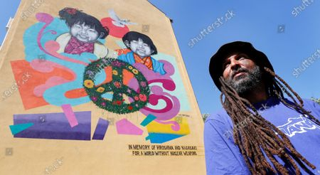 Street artist Jesus Cruz Artiles, aka 'Eme Freethinker' poses in front of his mural for the 75th anniversary of the atomic bombings of Hiroshima and Nagasaki, in Berlin, Germany, 05 August 2020. Commissioned by Greenpeace the 10x10 meter mural stands for Peace and against nuclear weapons. On 06 August 1945 the first atomic bomb was dropped on the Japanese city of Hiroshima and three days later a second bomb hit Nagasaki. Over 200,000 people died in the attacks.