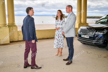 The Duke and Catherine Duchess of Cambridge meet with MD of Vale of Glamorgan Council, Rob Thomas, as they arrive by car to visit beach huts, during their visit to Barry Island, South Wales, to speak to local business owners about the impact of Covid-19 on the tourism sector