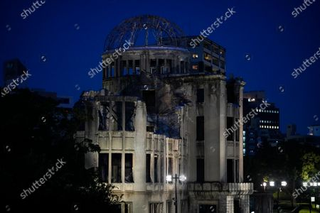 The Atomic Bomb Dome is lit up in the evening at Peace Memorial Park in Hiroshima, western Japan, 05 August 2020. On 06 August 2020 Japan will mark the 75th anniversary of the bombing of Hiroshima. In 1945 the United States dropped two nuclear bombs over the cities of Hiroshima and Nagasaki on 06 and 09 August respectively, killing more than 200,000 people. This year's annual commemoration events were either canceled or scaled down amid the ongoing coronavirus pandemic.