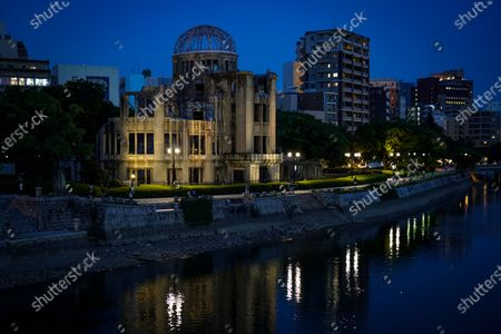 People enjoy evening walk around the Atomic Bomb Dome along the  Motoyasu River at Peace Memorial Park in Hiroshima, western Japan, 05 August 2020. On 06 August 2020 Japan will mark the 75th anniversary of the bombing of Hiroshima. In 1945 the United States dropped two nuclear bombs over the cities of Hiroshima and Nagasaki on 06 and 09 August respectively, killing more than 200,000 people. This year's annual commemoration events were either canceled or scaled down amid the ongoing coronavirus pandemic.