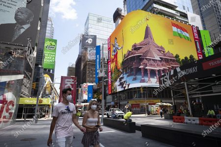 People pass by the imagery of the Hindu deity Ram and 3-D portraits of the proposed Hindu temple are displayed on a digital billboard in Time Square, New York, to celebrate the groundbreaking ceremony of a temple dedicated to the Hindu god Ram by Indian Prime Minister Narendra Modi in Ayodhya, in New Delhi, India. Hindus rejoiced as Modi broke ground on a long-awaited temple of their most revered god, Ram, at the site of a demolished 16th century mosque