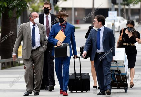 Michael Lockwood, third from left, arrives at the Stanley Mosk Courthouse for the third day of his divorce trial with Lisa Marie Presley, in Los Angeles. Presley and Lockwood wed in 2006 and filed for divorce in 2016