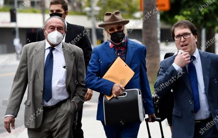 Stock Picture of Michael Lockwood, center, arrives at the Stanley Mosk Courthouse for the third day of his divorce trial with Lisa Marie Presley, in Los Angeles. Presley and Lockwood wed in 2006 and filed for divorce in 2016