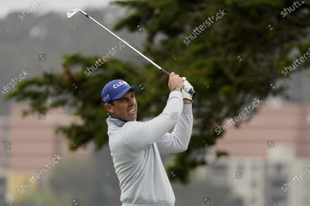 Charl Schwartzel watches his tee shot on the 17th hold during a practice round for the PGA Championship golf tournament at TPC Harding Park, in San Francisco