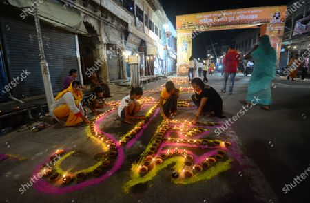 People light earthen lamps to celebrate the Bhumi Pujan of the Ram Temple on August 5, 2020 in Ayodhya, India. Prime Minister Narendra Modi said on Wednesday the construction of Ram temple will not only add to Ayodhya's grandeur but will also change the entire economy of the region after laying the foundation stone in accordance with the 'muhurat' or auspicious time.