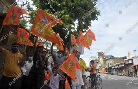 Local residents celebrating with saffron flags on the day of the foundation laying of the Ram Temple on August 5, 2020 in Ayodhya, India. Prime Minister Narendra Modi said on Wednesday the construction of Ram temple will not only add to Ayodhya's grandeur but will also change the entire economy of the region after laying the foundation stone in accordance with the 'muhurat' or auspicious time.