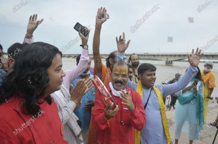 Local residents celebrating on the day of the foundation laying of the Ram Temple on August 5, 2020 in Ayodhya, India. Prime Minister Narendra Modi said on Wednesday the construction of Ram temple will not only add to Ayodhya's grandeur but will also change the entire economy of the region after laying the foundation stone in accordance with the 'muhurat' or auspicious time.